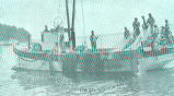 [Fishing boat with fishermen with nets]