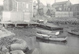 Scene along the river front at Fairhaven, showing a quahaug shanty and several skiffs, which are...