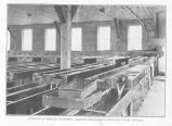 Interior of Karluk Hatchery. Salmon egg baskets removed from trough