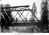 Men on a bridge, probably bridge builders on the Olympic Peninsula