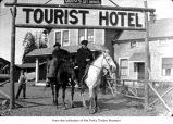 Men on horses near the Tourist Hotel in Forks