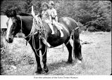 Children on a horse, probably on the Olympic Peninsula
