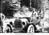 Men in a Ford car, probably on the Olympic Peninsula in the 1910s