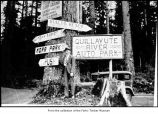 Man at the Quillayute River Auto Park signs in Clallam County