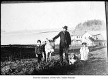 Samuel Morse with children, a donkey and a dog at Neah Bay