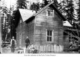 Men posing outside a house, probably pioneers of the Olympic Peninsula