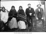 Native American women with two white men, probably on the Olympic Peninsula