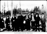 People standing near a bus, probably on the Olympic Peninsula