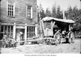 People with a cart, probably pioneers on the Olympic Peninsula