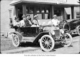 Men in a car, probably on the Olympic Peninsula in the 1910s