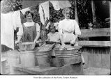 Women and a girl washing clothes, probably on the Olympic Peninsula