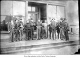 Men outside a store, probably pioneers on the Olympic Peninsula