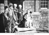 Elderly couple with two children, probably pioneers on the Olympic Peninsula