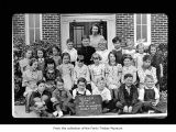 Beaver School students with Miss McNaugton outside school, probably in Beaver