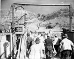 Workers disembarking from barge, ca. 1940.