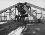 Machinery at the Grand Coulee construction site with snow on ground, ca. 1933-1941