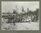 Harriman Alaska Expedition party on the beach at a deserted Tlingit Indian village, Cape Fox,...