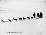 Dogsled team with four men, vicinity of Dawson, Yukon Territory, ca. 1898.