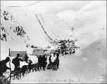 Klondikers with supplies at The Scales, preparing to ascend to the summit of Chilkoot Pass,...