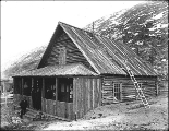 Log cabin serving as the post office at Bennett, British Columbia, June 4, 1899.