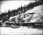 Log bridge on the White Pass Trail, Alaska, ca. 1898.
