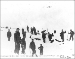 Klondikers recovering the bodies of the tramway workers buried in the avalanche on Chilkoot Pass,...
