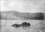 Scow loaded with men and supplies sinking at WhiteHorse Rapids, Yukon River, Yukon Territory, ca....