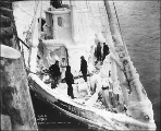 Steamer tug RESOLUTE covered with ice at dock, Skagway, Alaska, March 10, 1900