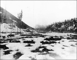 Blasting rock for the construction of the White Pass & Yukon Railroad near Whitehorse, Yukon...