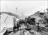 Senator Charles Warren Fairbanks and party arriving on the White Pass and Yukon Railroad, summit...