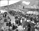 Crowd gathered to watch race, Front St., Dawson, Yukon Territory, ca. 1899.