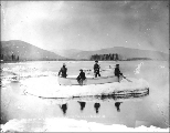 Four men in a canoe adrift on an ice floe on the Yukon River, Yukon Territory, ca. 1898.