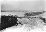 Bridge over rapids below Deep Lake, White Pass Trail, British Columbia, ca. 1898.