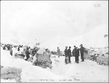 Klondikers and supplies on the summit of White Pass, Alaska, 1898.