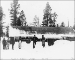 North-West Mounted Police officers standing in front of barracks, Log Cabin, British Columbia,...