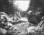 Man and partner hauling sled, White Pass Trail, Skagway River, Alaska, ca. 1898.