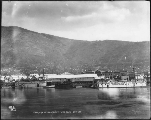 Canadian Development Co.'s dock on the Yukon River viewed from the water, Dawson, Yukon Territory,...