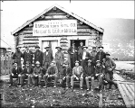 Men in front of the offices of the Dawson Town Site Co. and the Harper & Ladue Mill Co,...