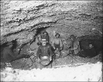 Miners thawing frozen ground with steam in an underground gold mine lit by candlelight, Gold Hill,...