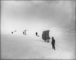Crossing frozen Crater Lake with sleds outfitted with sails, British Columbia, 1898.