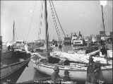 Boats moored along the Snake River, Nome, Alaska, June 29, 1900.