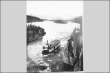Steamboat ORA navigating Five Finger Rapids on the Yukon River, Yukon Territory, ca. 1898.