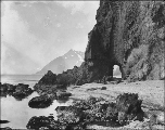 Formation called Hole in the Wall, at the beach in Dutch Harbor, Alaska, ca. 1901.