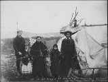 Family group, possibly Kutchin Indians, outside of tent dwelling, Fortymile, Yukon Territory, ca....