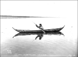Indian in birchbark canoe, Lower Yukon River, probably Alaska, ca. 1901.