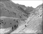 Klondikers hiking through Cutoff Canyon, White Pass Trail, Alaska, ca. 1898.