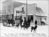 Dogsled team departing for Dawson in front of Hegg's photography studio, Skagway, Alaska, ca. 1898.