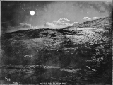 Gold Hill and mouth of Skookum Creek photographed by moonlight, Yukon Territory, ca. 1898.