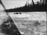 Boat navigating Rink Rapids on the Yukon River, Yukon Territory, ca. 1898.