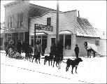 Dog team in front of Hegg's photography studio, Skagway, Alaska, ca. 1898.